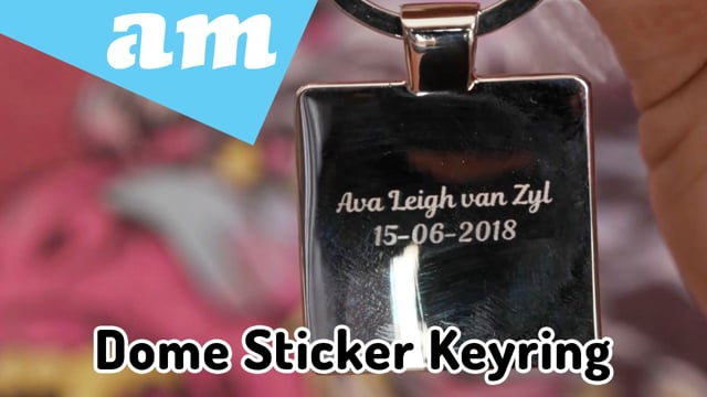 Dome Sticker Keyring Made on LabelMark Fiber Laser Engraving and Dome Resin on Printed Sticker