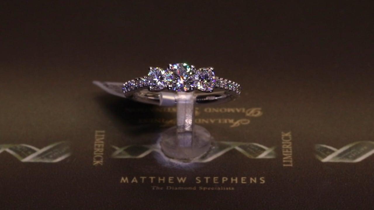 75119 - Three Stone Round Brilliant with Diamond Set Shoulders, T1.15ct, Set in Platinum