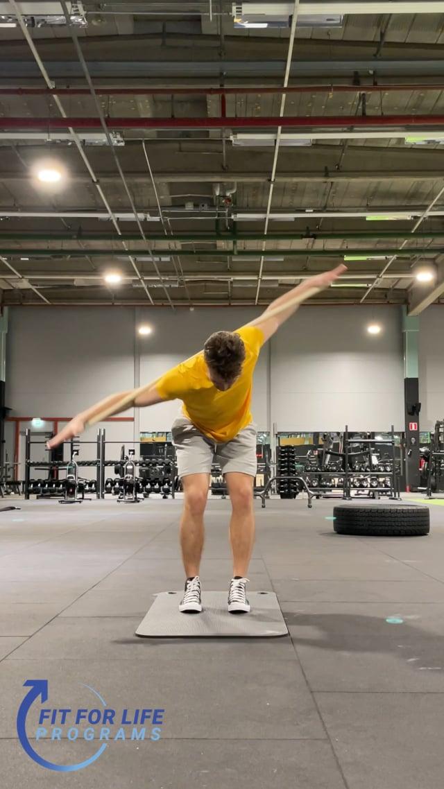 Dynamic Stretching, bent over stick twist