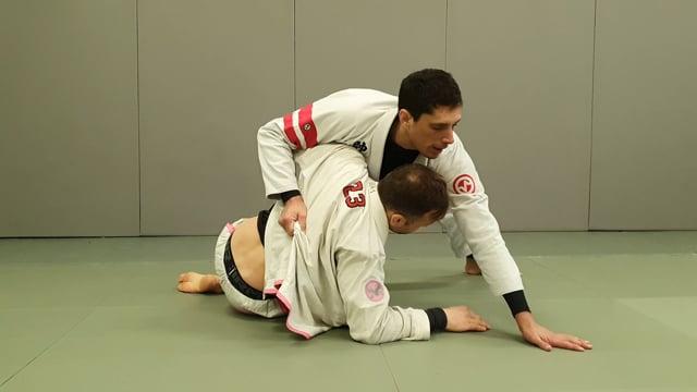 Passage de demi garde en knee slide quand l'adversaire prend l'underhook