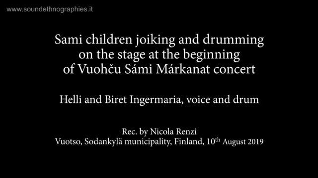 3 – Sami children (Helli and Biret Ingermaria) joiking and drumming on the stage at the beginning of Vuohču Sámi