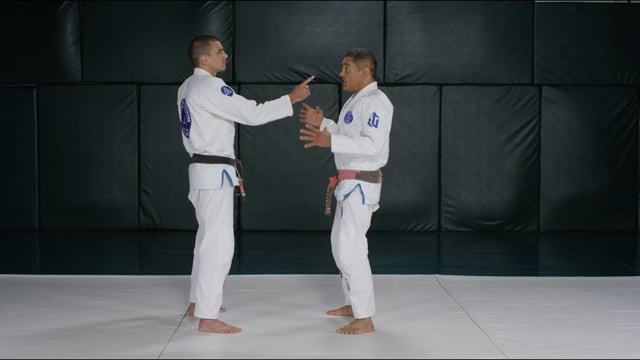 Finger pointing threat or single-hand neck grab defense