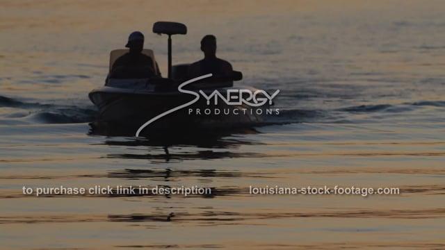 2928 silhouette of fishermen in fishing boat on lake