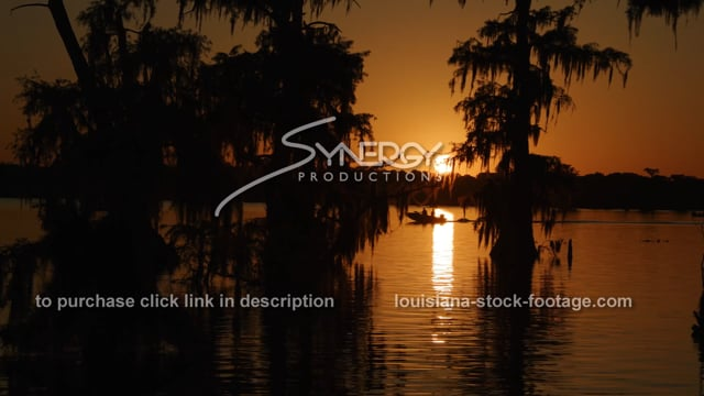 2931 fishing boat at sunset on Louisiana lake