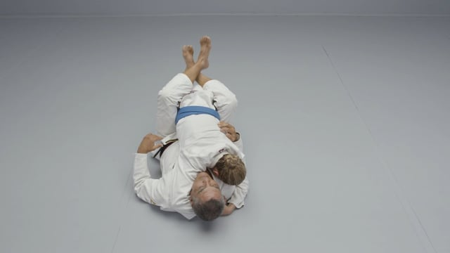 Learn the back-take Rickson Gracie used to win his first MMA fight