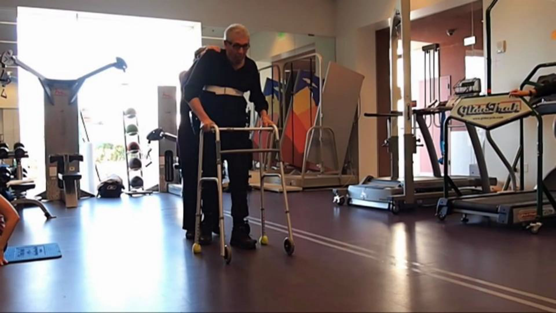 Kickstart helps user with spinal cord injury walk during physical therapy