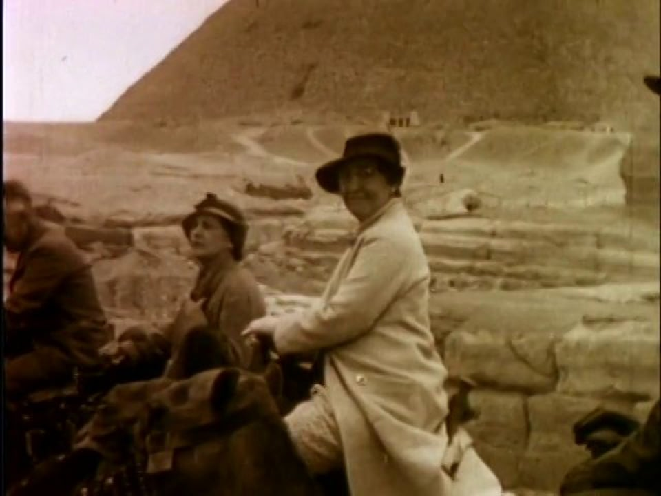 woman riding camel near the pyramids - 1935