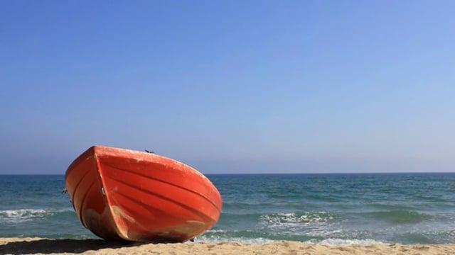 Orange Lifeboat on a Sandy Beach