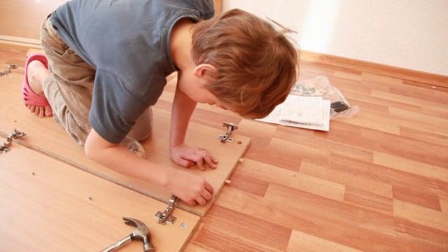 Boy Assembles Wood Furniture