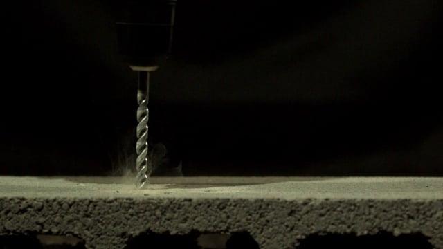 Cordless Drill Drilling into Concrete