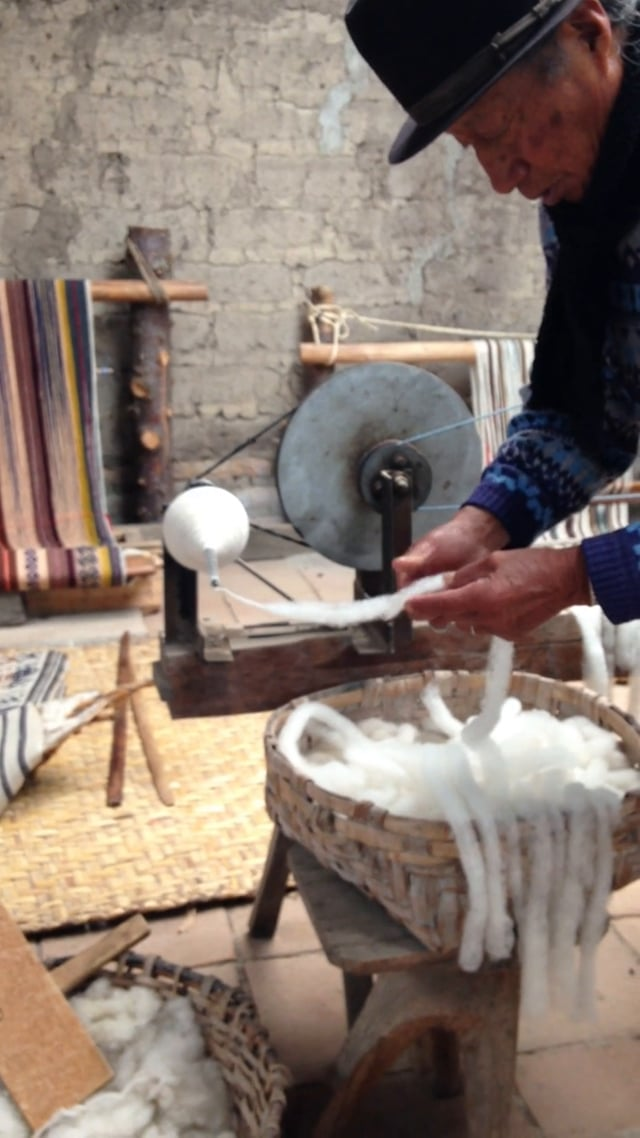 Spinning wool in the Andes
