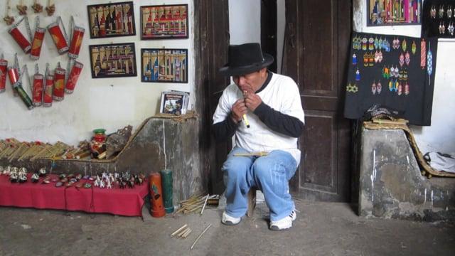 Crafting a pan flute in Otavalo region, Ecuador