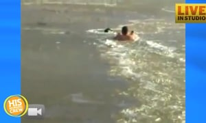 Man Breaks Through Ice to Save His Dog
