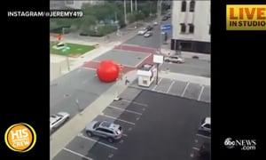 Huge Red Ball Rolls Down Street in Ohio
