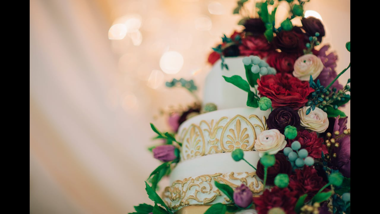 Jewel Tone Sugar Flower Wedding Cake and Art Deco Dessert Tent