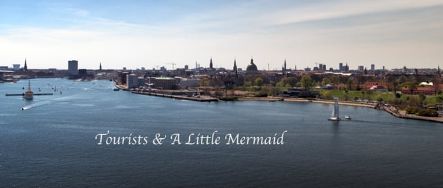 Tourists And A Little Mermaid