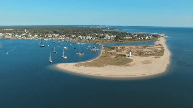 Idyllic Waterfront Living: Edgartown Village Retreat with 150-foot Long Deep Water Dock and Stunning Lighthouse Views