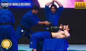 Man Chops 49 Melons on Friend's Abs to Break Record