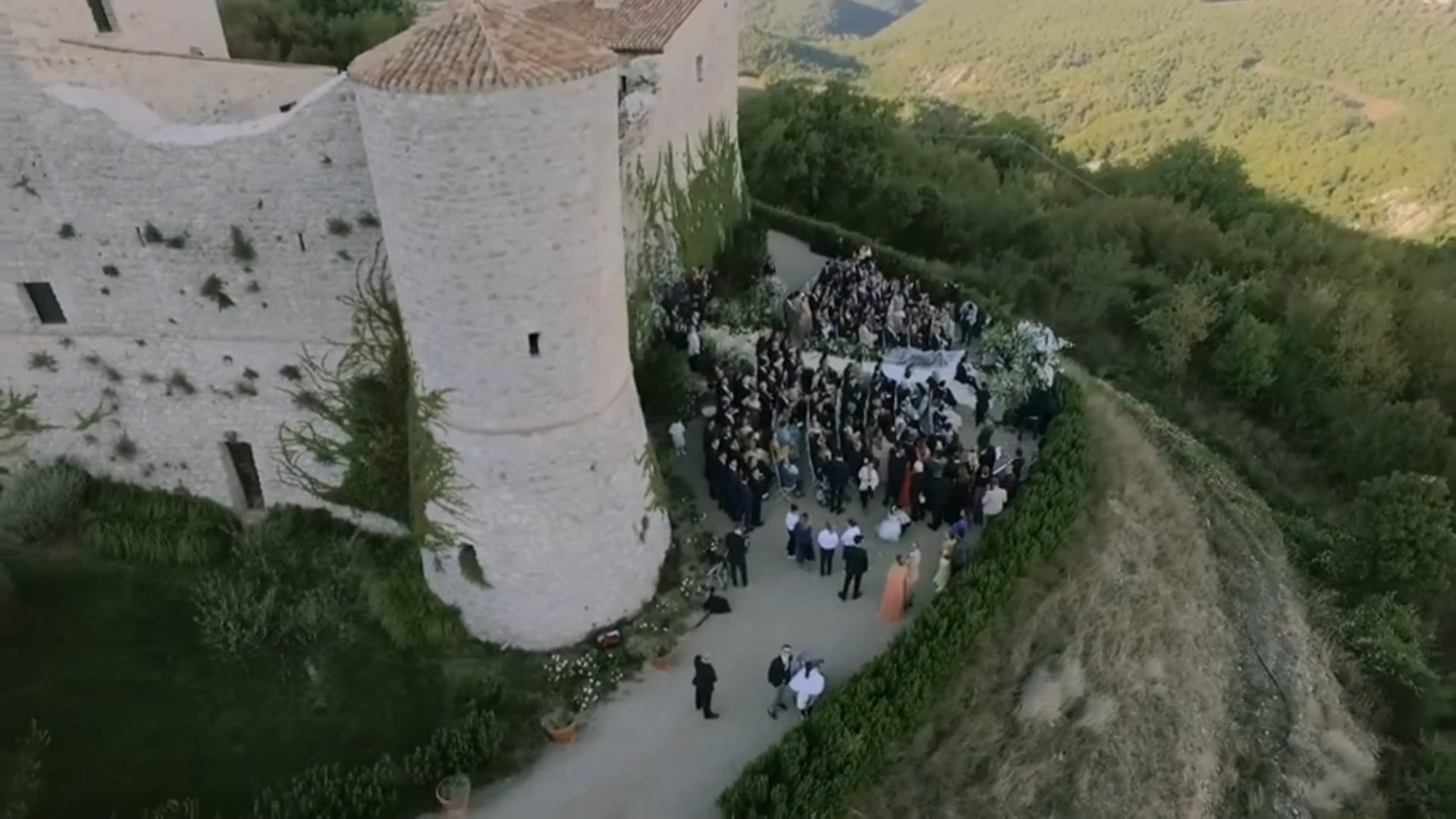 Breathtaking drone destination wedding video at a Middle Age Tower on the mountainside. Stunning location at Outer Mani, Greece