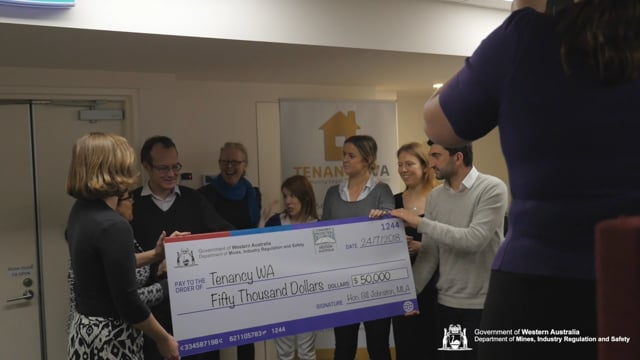 Commerce and Industrial Relations Minister Bill Johnston presents a $50,000 grant to Tenancy WA