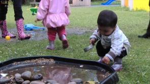 Watch Toddler explores natural materials & sound outdoors