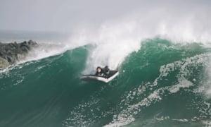 Surfer Rides Huge Wave on Inflatable Mattress