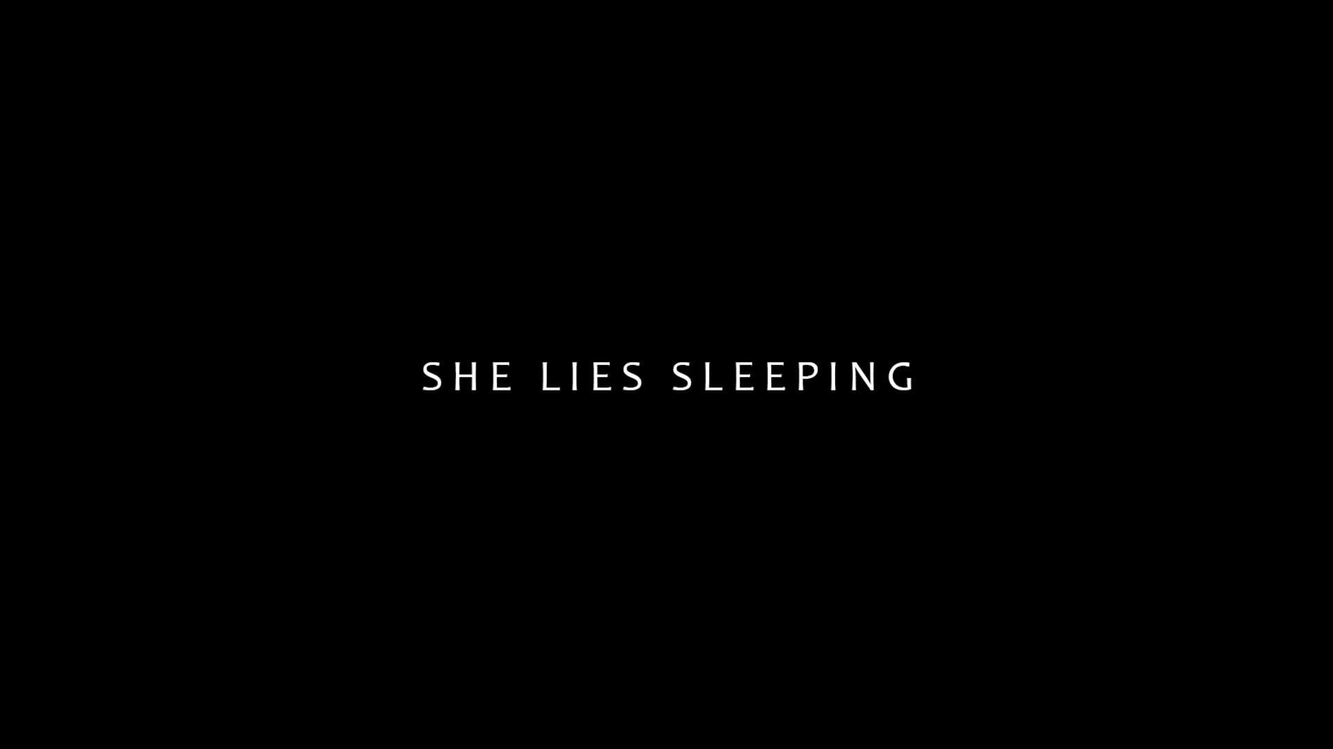 SHE LIES SLEEPING