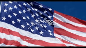 1282 fast pan of american flag video stock footage slow motion with blue sky