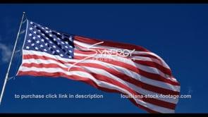1274 proud american flag blowing in breeze