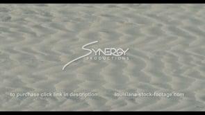 571 Wind blowing sand across beach coastal restoration video stock footage