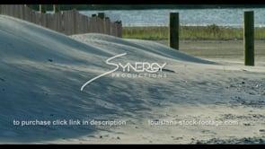 573 Pan across sand blowing over dune Louisiana coastal restoration example video stock footage