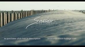 579 Epic awesome shot wind blowing sand across Louisiana coastal restoration beach