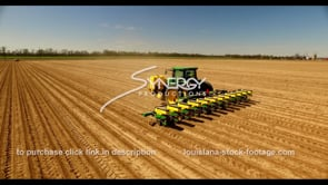 683 Epic shot planting corn soybean cotton on American farm aerial drone stock footage video