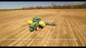 684 Nice aerial drone arc around tractor planting during springtime stock footage video