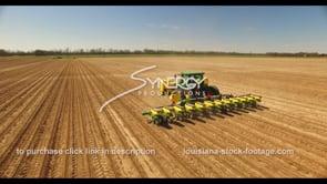 688 CU aerial drone following farmer planting seeds