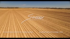689 epic aerial drone wide shot tractor planting crops in field stock video footage