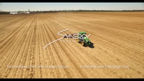 690 farmer on tractor forming flat rows aerial