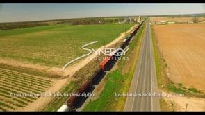 691 Freight train transportation running through Louisiana farmland