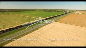 692 freight train traveling thru farmland of America
