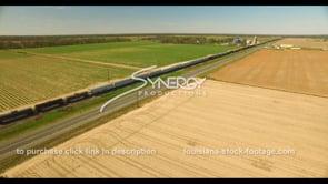 693 Epic aerial drone view train traveling thru farmland