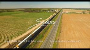 694 aerial view train delivering goods American farmland