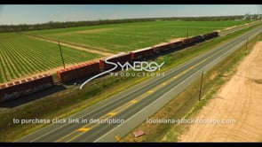 696 Epic aerial ascent of train racing thru farmland of america stock footage video