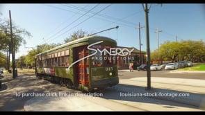 1066 riding alongside New Orleans streetcar