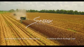 1031 Aerial drone arc around farmer harvesting corn for world commodity export trade