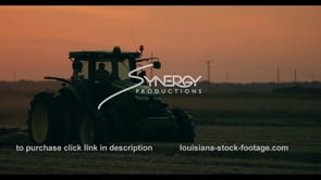 744 tractor on farm at sunset