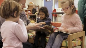 Watch Aziah looks at books