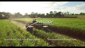 859 John Deere tractor harvesting sugarcane aerial drone video stock footage