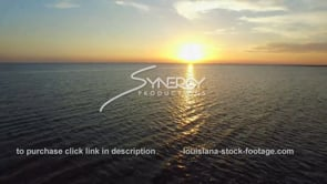 034 epic lake pontchartrain sunset aerial drone tilt up into awesome sunset