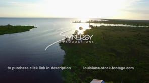 035 lake ponchatrain fishing camp aerial drone fly over at sunset near new orleans louisiana