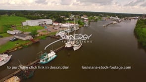 104 Aerial drone view of shrimp boats docked on the bayou